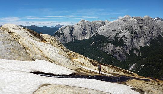 Grant Simmons exploring Cerro Arco Iris's summit plateau