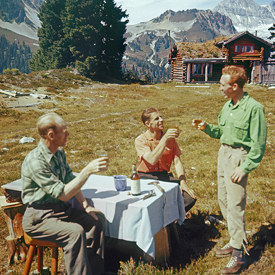 Beckey, center, MacDonald, right, both legendary climbers, sip Canadian Club whiskey after a climb, ca. 1958. Man at left is unidentified. [Photo] Ed Cooper