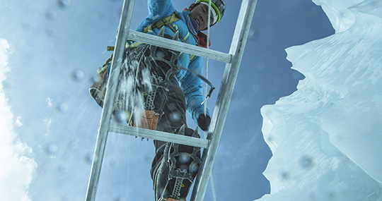 Nawang Sherpa on a ladder crossing