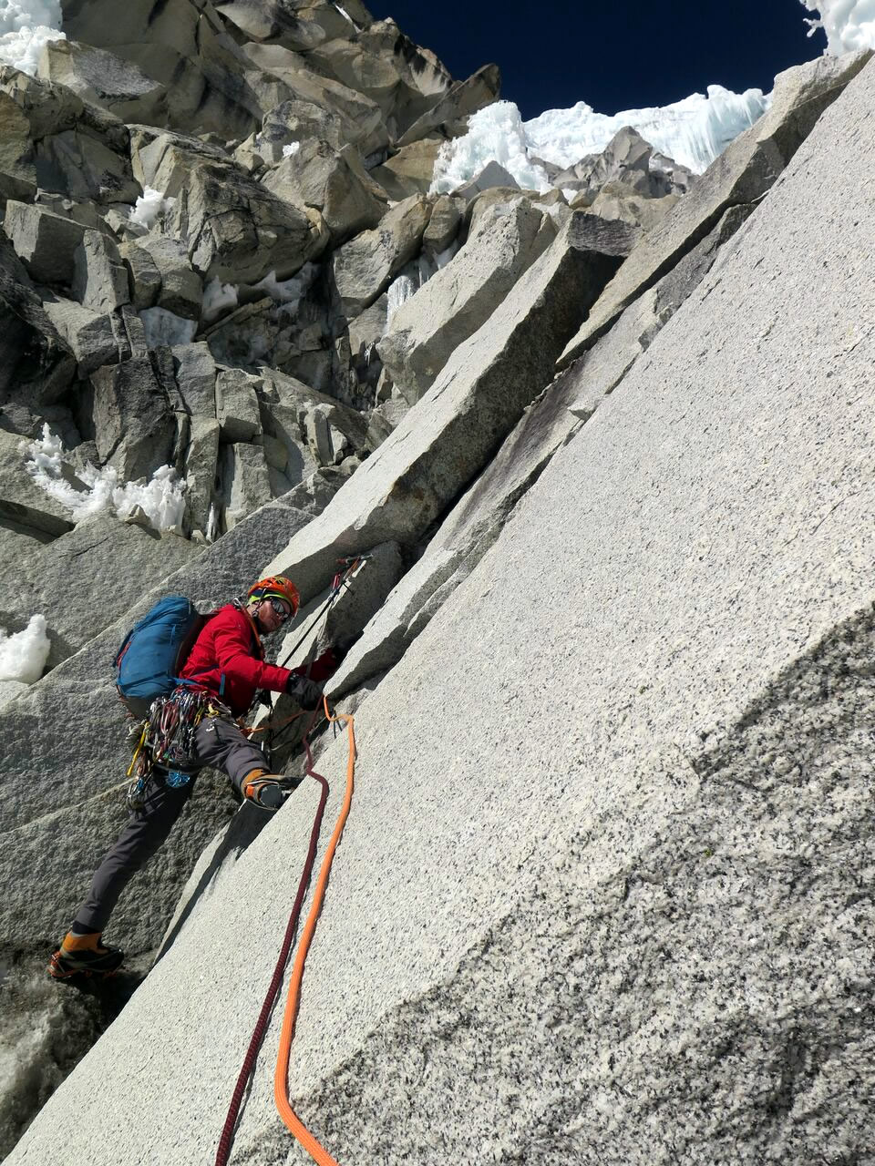 Ben Dare leading the first pitch of mixed terrain on the peak's upper north face. [Photo] Steve Skelton
