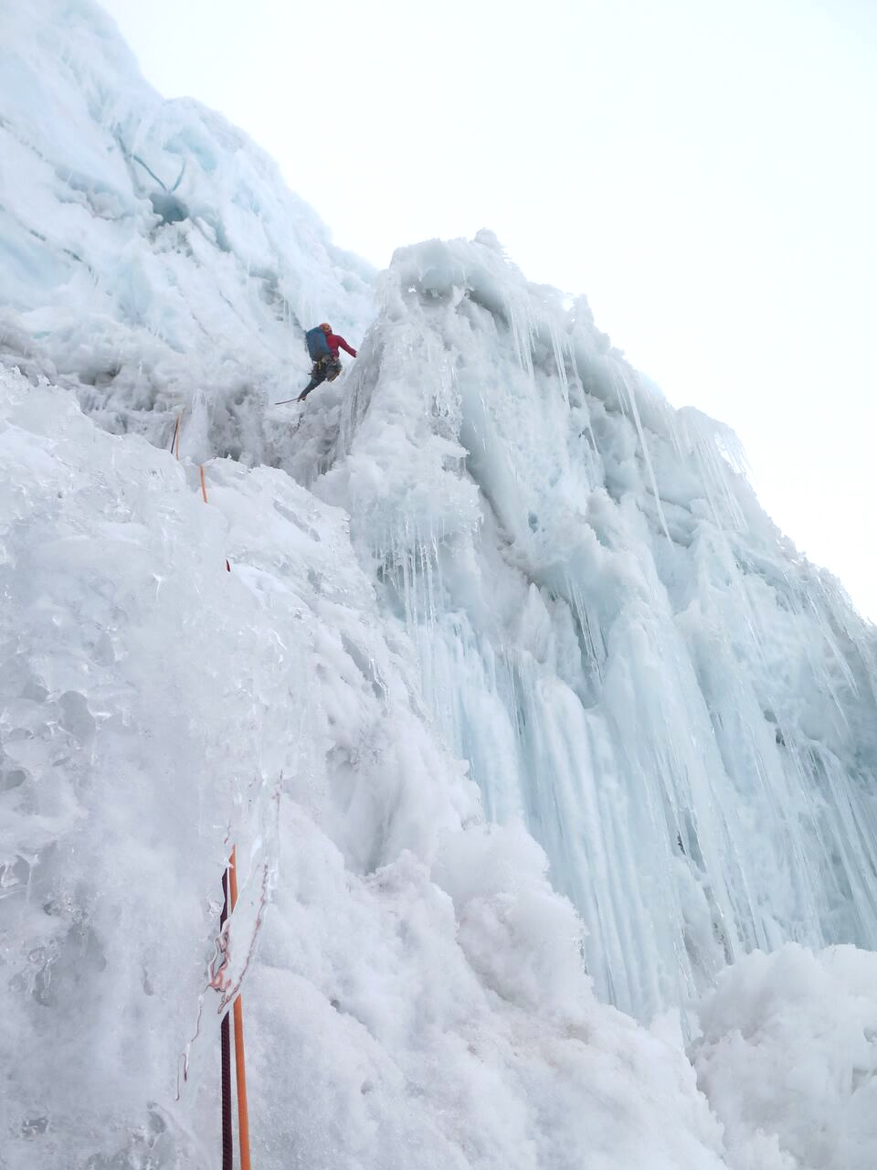 Ben Dare navigating the final overhanging ice pitch which topps out directly on the summit. [Photo] Steve Skelton