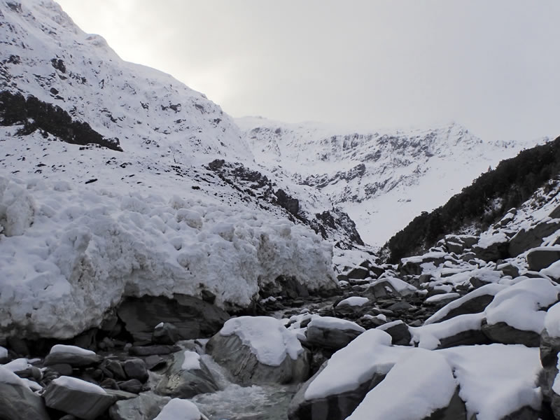 The approach up Rainbow Stream, with the fresh avalanche debris from the upper slopes of Moncrieff Peak that had partially blocked the stream. [Photo] Ben Dare