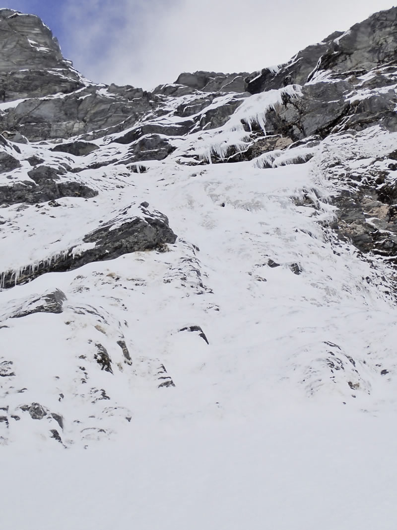 The final steep section of ice leading to the snow slopes below the North Ridge. [Photo] Ben Dare