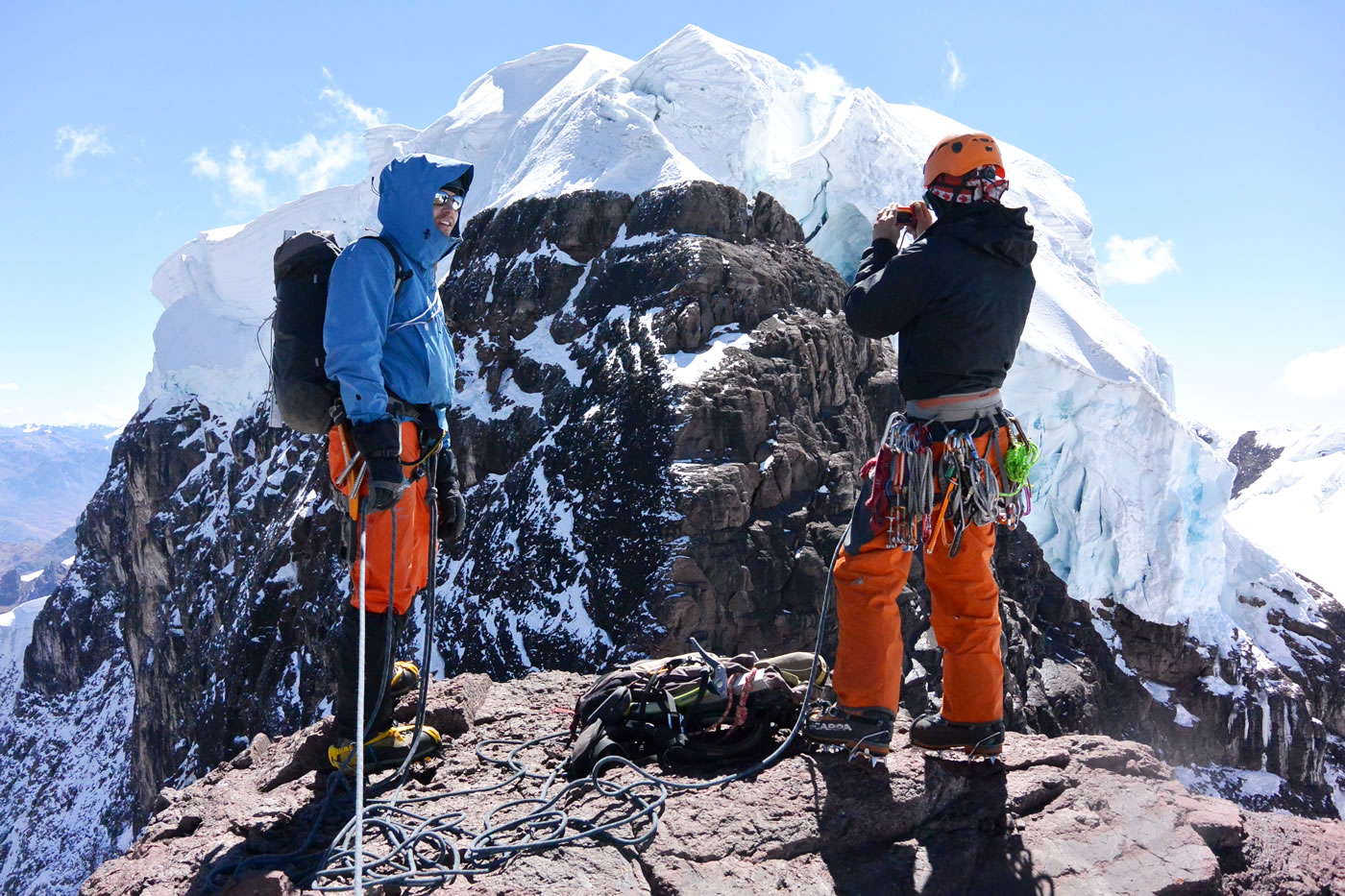 Field and Zimmerman gaze at Allincapac (5780) from the summit of Pico Carol. [Photo] Nathan Heald