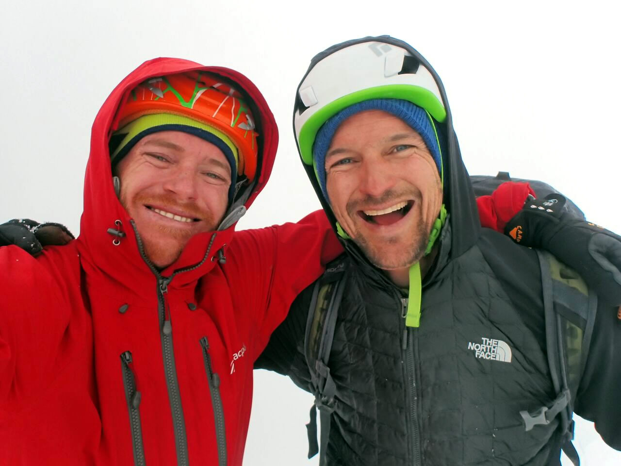 Ben Dare (left) and Steve Skelton (right), happy and a little teary eyed on a view-less summit after completing their new route on Taulliraju. [Photo] Ben Dare