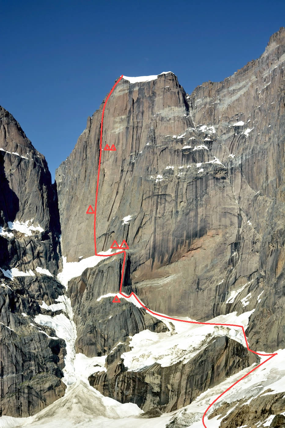 This photo has the team's new route, Metrophobia (7a A2+ 120-degree ice 1700m), marked in red on the west face of Greenland's Apostelens Tommelfinger (2315m).