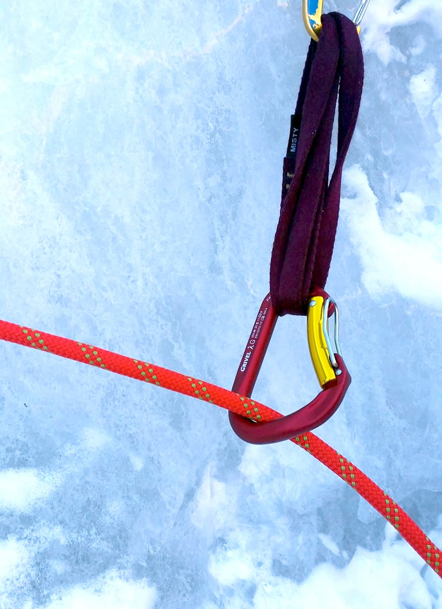 The Grivel Lambda HMS Twin Gate proved burly and reliable for clipping crucial pieces of gear, such as this high first screw on a particularly thin Coors Lite (WI2-3, 300') in Clear Creek Canyon, Colorado. [Photo] Alexander Kenan