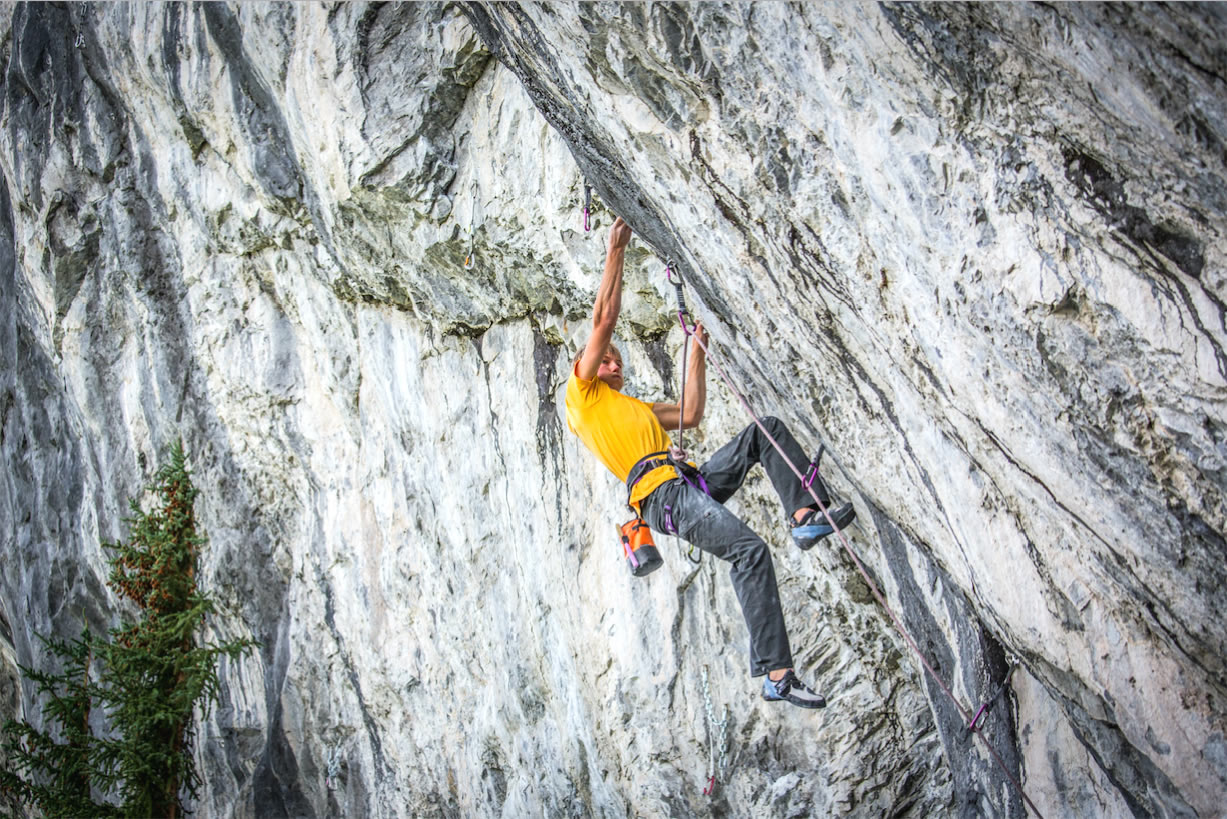 Alex Megos gets a grip on Fight Club (5.15b) at Raven's Crag near Banff, Canada. Megos made the first ascent of the route in August, establishing the country's first 5.15 as well as the second 5.15b in all of North America. A few days later Megos flashed The Path, a 5.14 R trad route. [Photo] Sonnie Trotter