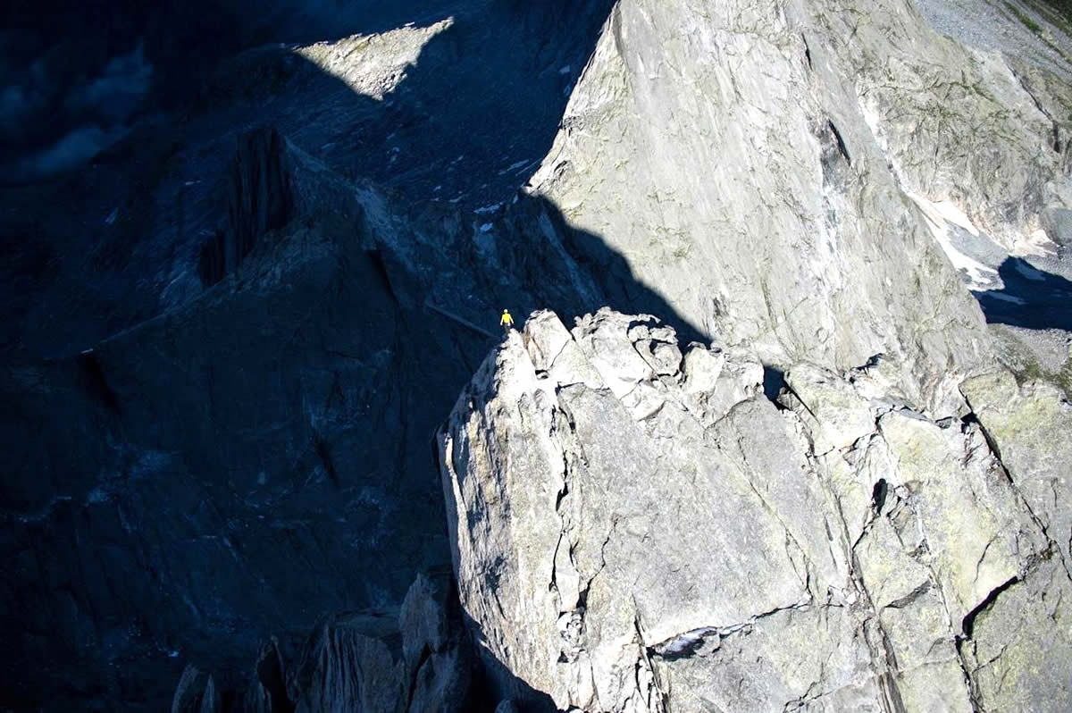 Arnold stands atop Switzerland's Piz Badile (3308m) after free soloing the Via Cassin (6a or 5.10a 800m) in 52 minutes. [Photo] Dani Arnold collection
