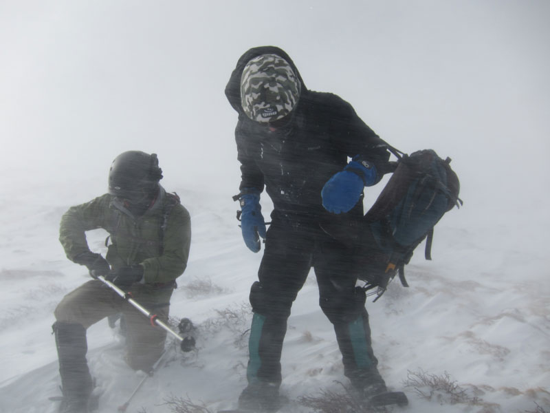 Elliot Demos and Jim Detterline battle a ground blizzard below Granite Pass, December 2011. The photographer recalls, Jim, Elliot and I climbed Longs Peak via the North Face that day. With that December descent, I became the first woman to climb Longs Peak in every month of the year. [Photo] Lisa Foster
