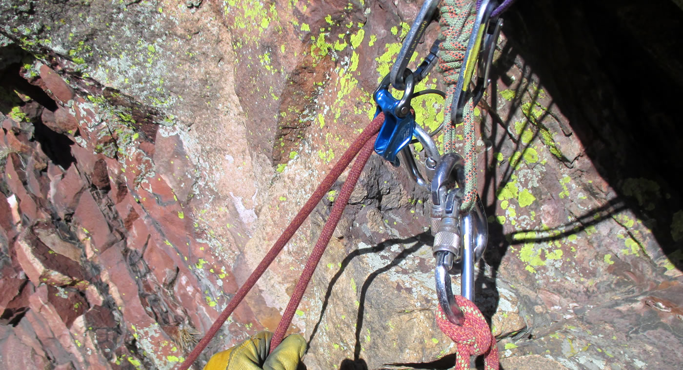 The DMM Pivot is an assisted-braking belay device that works well for top-belaying a climber directly from the anchor, as shown here. [Photo] Peter Braam