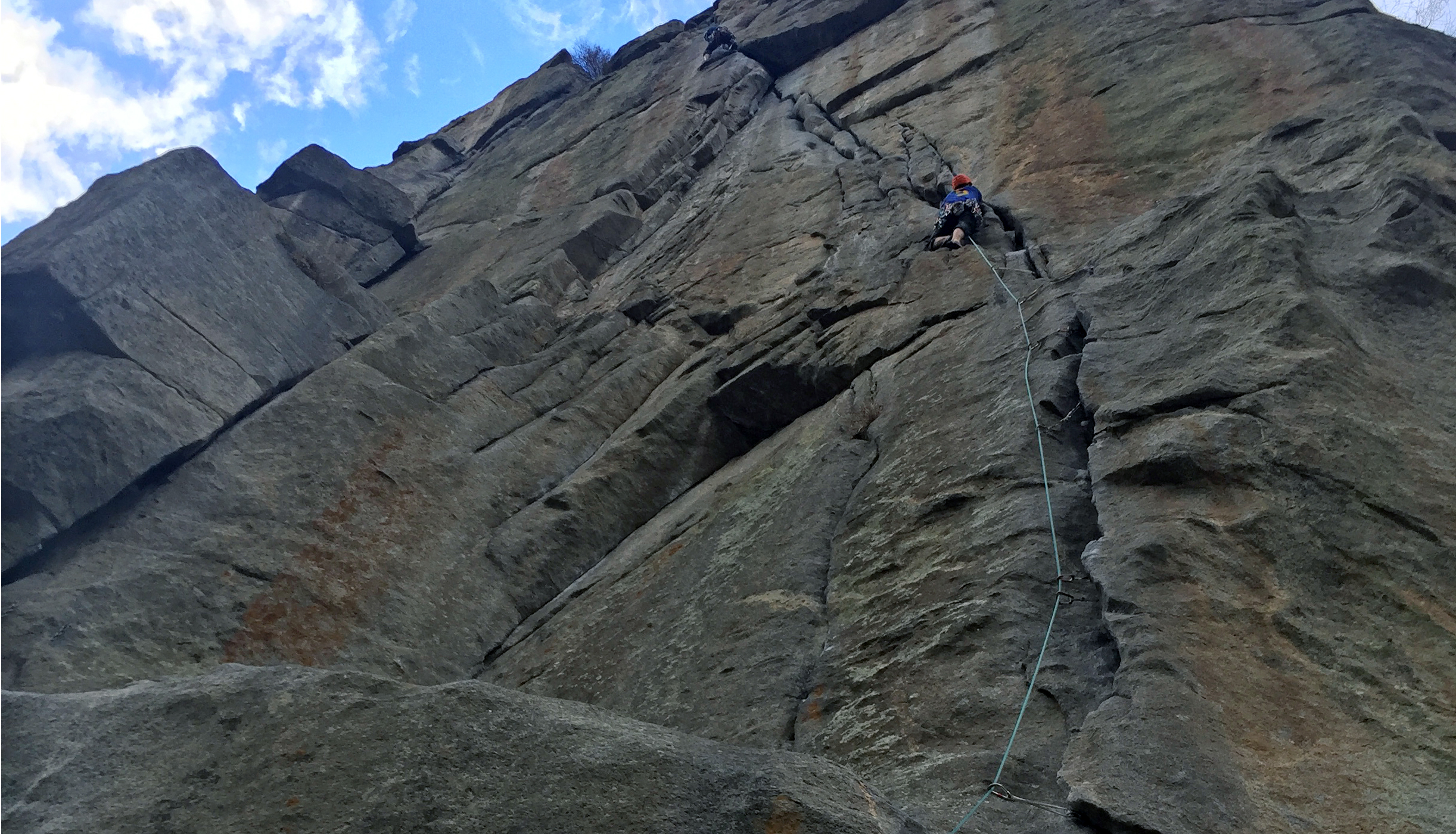 Peter Holben leads Country Club Crack (5.11b/c) at Castle Rock in Boulder Canyon, Colorado, in one 150-foot pitch. [Photo] Chris Van Leuven
