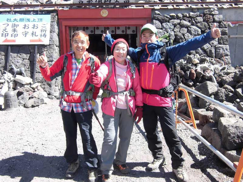 Pictured from left to right are Masanobu, Junko and Shinya Tabei in 2013 on Junko's annual ascent of Mt. Fuji (3776m) with a group of students from Fukushima, Japan. [Photo] Tabei family collection