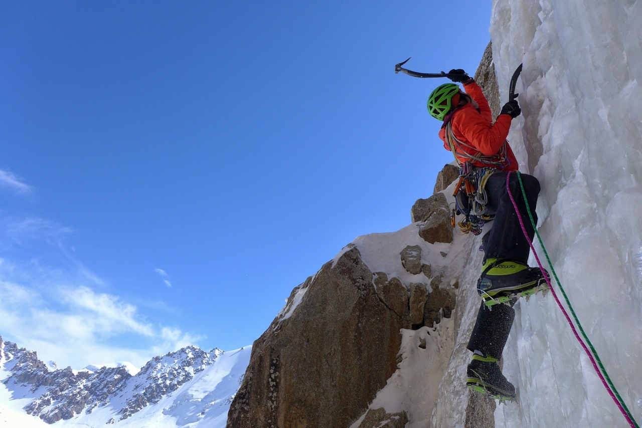 Papert swings into good ice about halfway up the new route. [Photo] Luka Lindic
