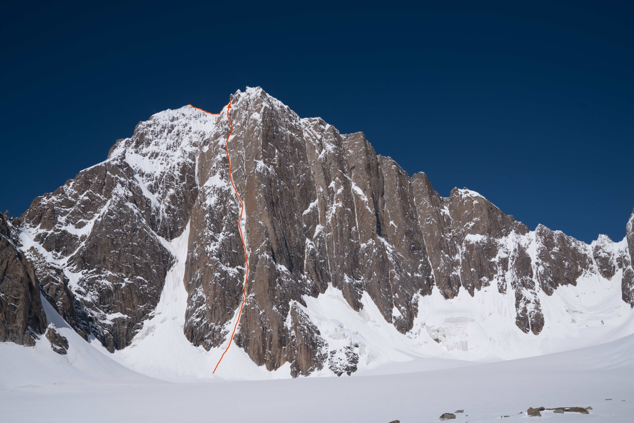 This photo of the southeast face of Kyzyl Asker (5842m) shows Ines Papert and Luka Lindic's new route, Lost in China (ED WI5+ M6, 1200m), in red. [Photo] Ines Papert and Luka Lindic