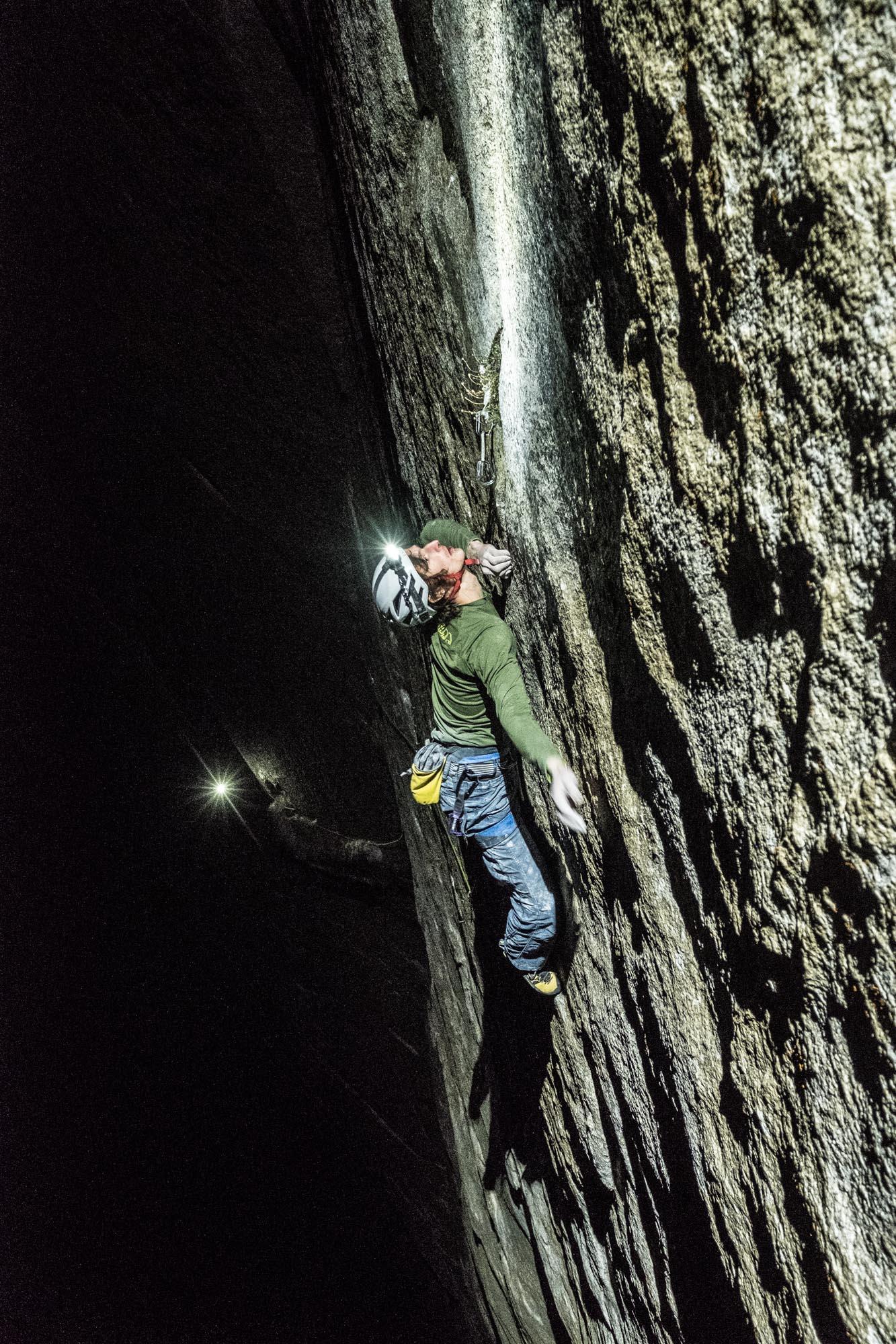 Ondra climbs Pitch 21 (5.13d) by headlamp. [Photo] Heinz Zak and Black Diamond Equipment