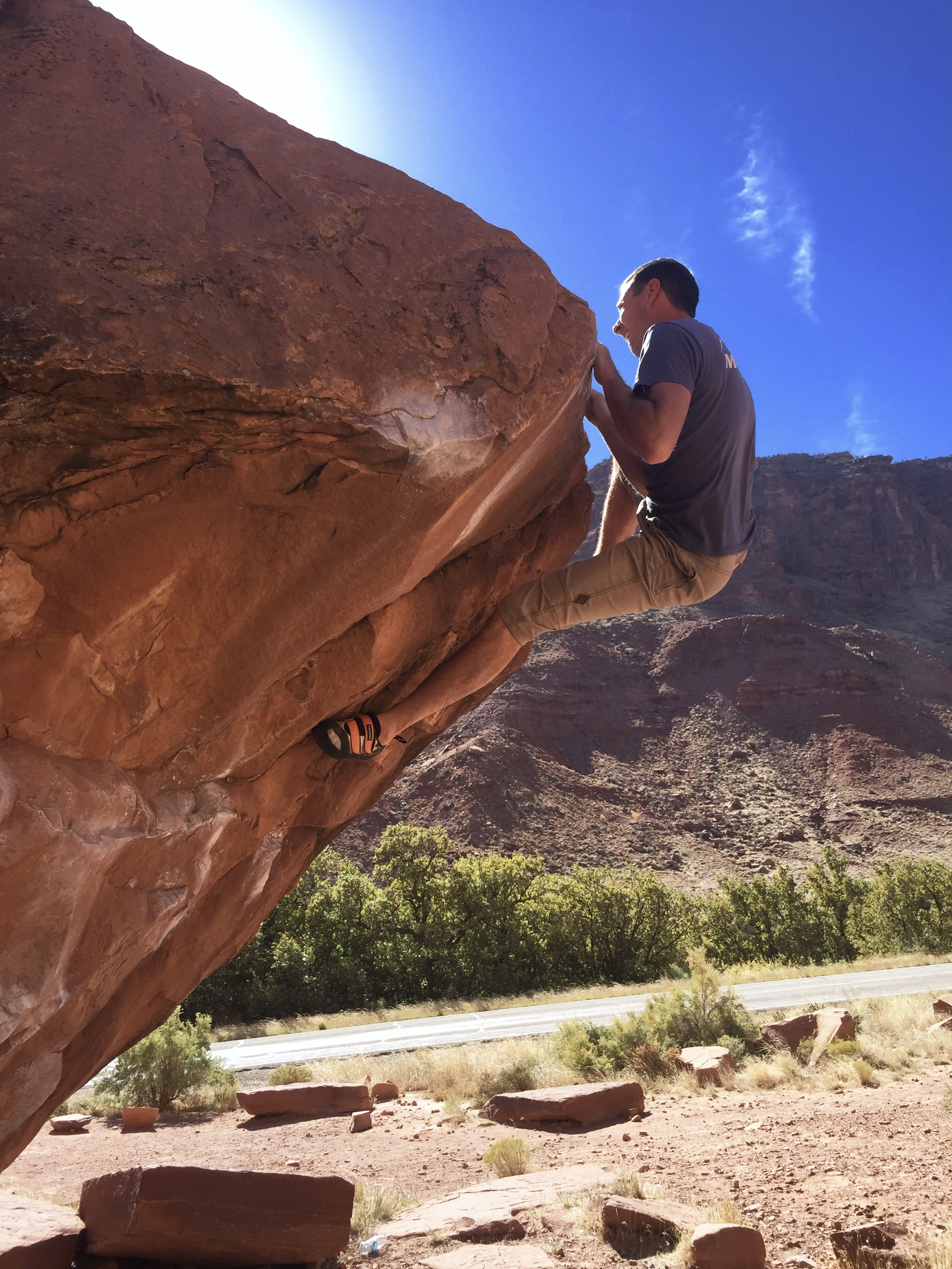 Mike Lewis rocks onto his right foot to finish Circus Trick (V5) at the Big Bend Boulders near Moab, Utah. [Photo] Drew Maloney