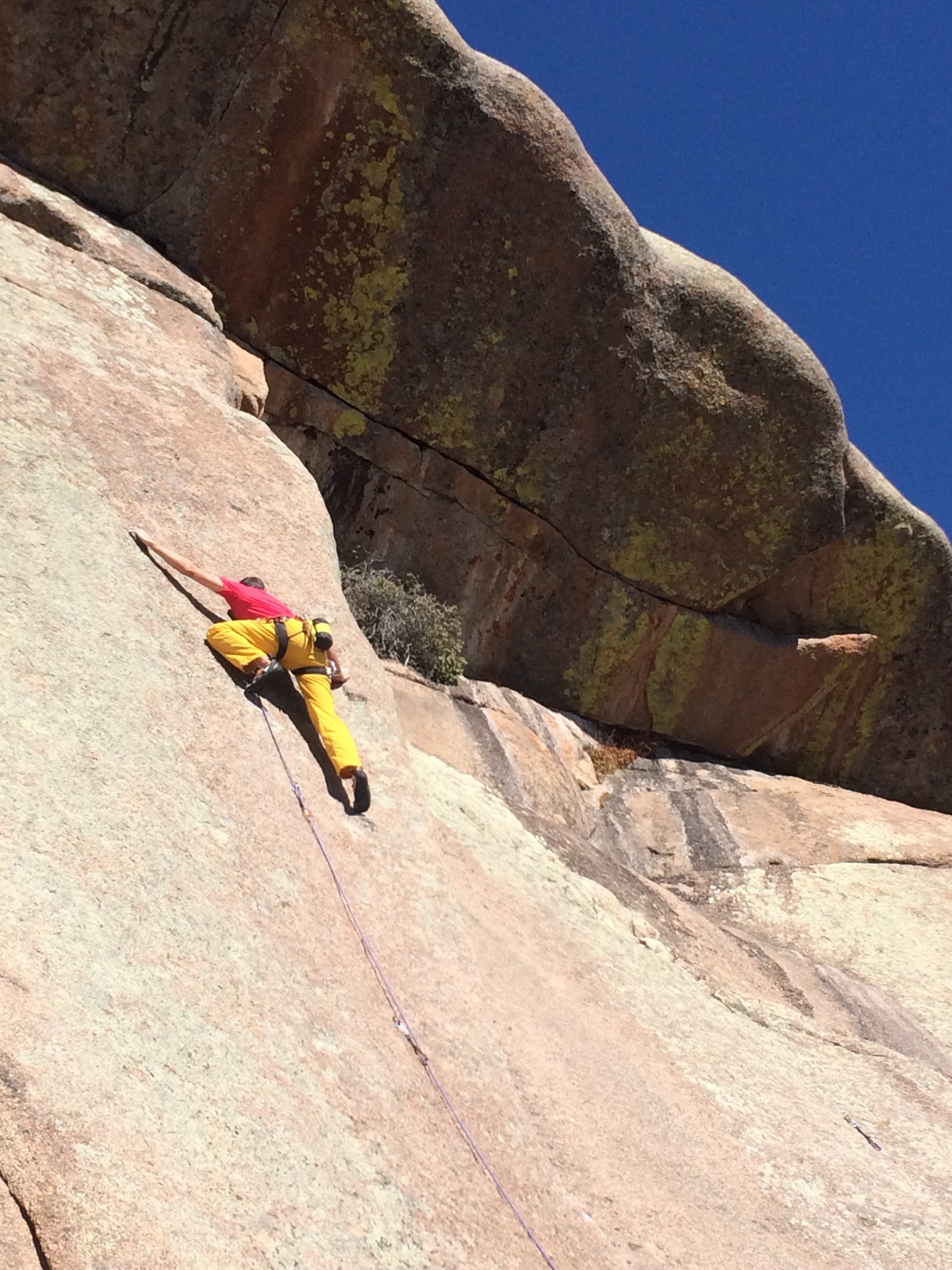 Mike Lewis delicately edges up a steep slab route called Sport (5.10d) in Vedauwoo, Wyoming. [Photo] Lodi Siefer