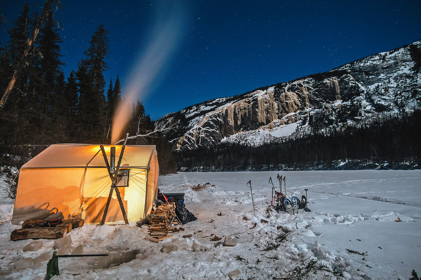 Base camp on the frozen Nipissis River below the M51 cliff, in Nitassinan, the Innu name for this land that overlaps with northeastern Quebec. [Photo] Maarten van Haeren
