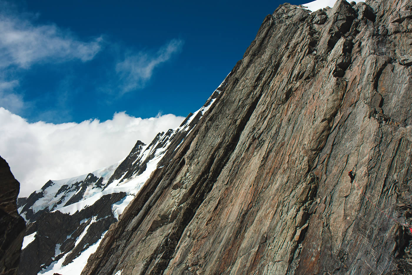 Jamie Vinton-Boot near the end of Stuntman and Chronic (5.9, five pitches) before the West Rib (5.8, eight pitches) of Mt. Walter. In the background is the West Ridge of Elie de Beaumont. [Photo] Kester Brown