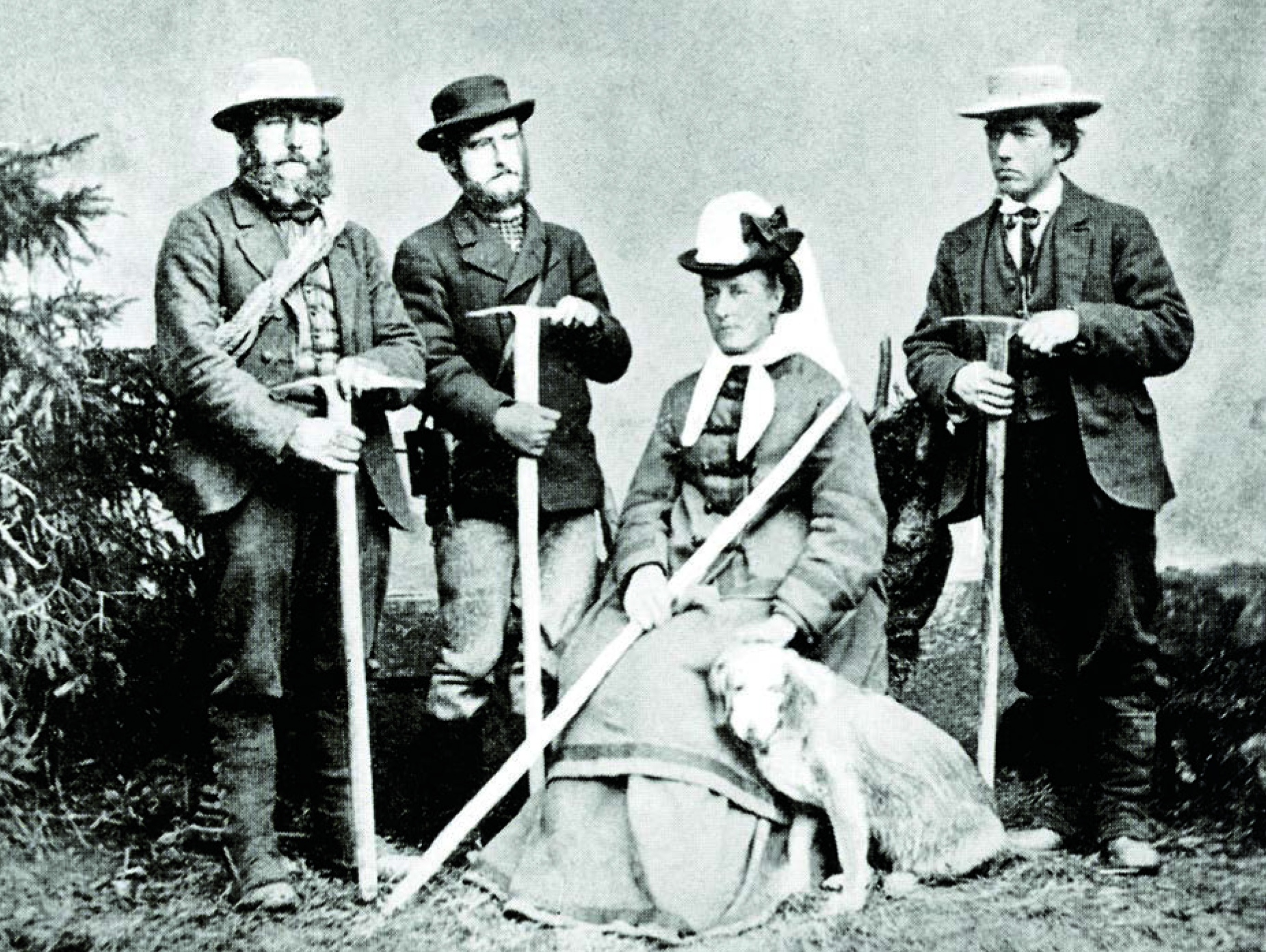 William Coolidge with his aunt, Meta Brevoort, their guides Christian Almer (far left) and Ulrich Almer (Christian's son, second left,) and dog Tschingel, circa 1874. [Photo] Courtesy of the Alpine Club
