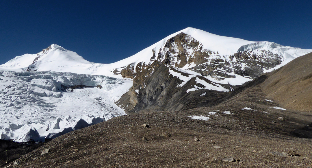 Purkung and an unnamed 6,000m peak to its left (southeast). The 2017 route of ascent on Purkung more or less followed the right skyline.  [Photo] Paulo Grobel