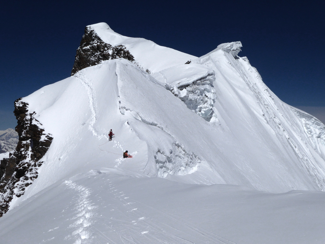 Isabelle Guillaume and Jangbu Sherpa descending the east ridge of Himlung Himal (summit visible behind) en route to the first ascent of Himlung East. [Photo] Paulo Grobel
