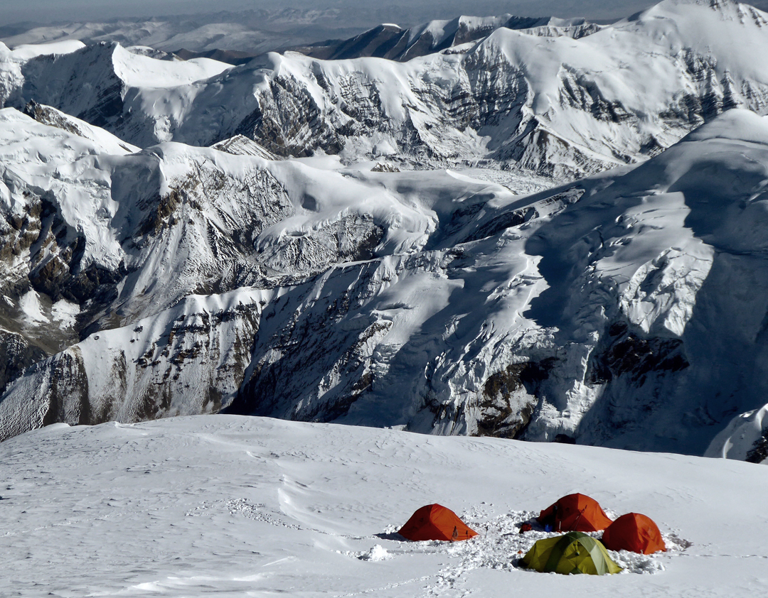 Camp 5 on Himlung Himal at 7050 meters, looking north-northwest to unclimbed summits on or close to the Tibetan border, southeast of Ratna Chuli. [Photo] Paulo Grobel
