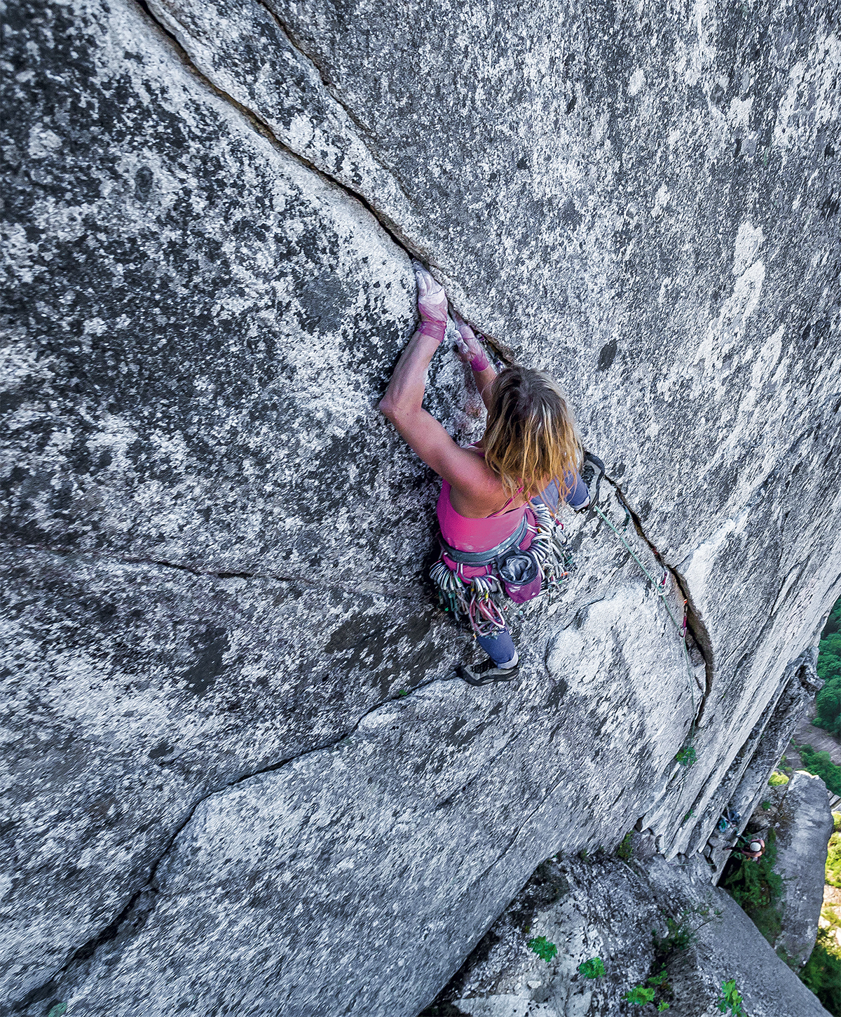 Anna Smith climbs High Plains Drifter (5.11c, 2 pitches) on the granitic Third Peak of the Stawamus Chief, Squamish, British Columbia. [Photo] John Price