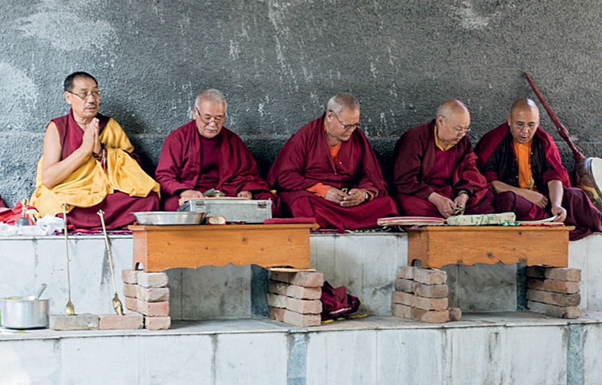 Buddhist monks during Smith's cremation ceremony. [Photo] Chris Gibisch