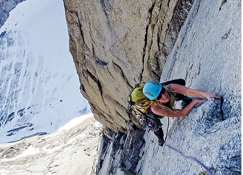 Smith on the South Buttress of Mt. Loki (5.10+, 650m), Baffin Island. Smith and Michelle Kadatz made the first all-female ascent of the route in 2015. [Photo] Michelle Kadatz