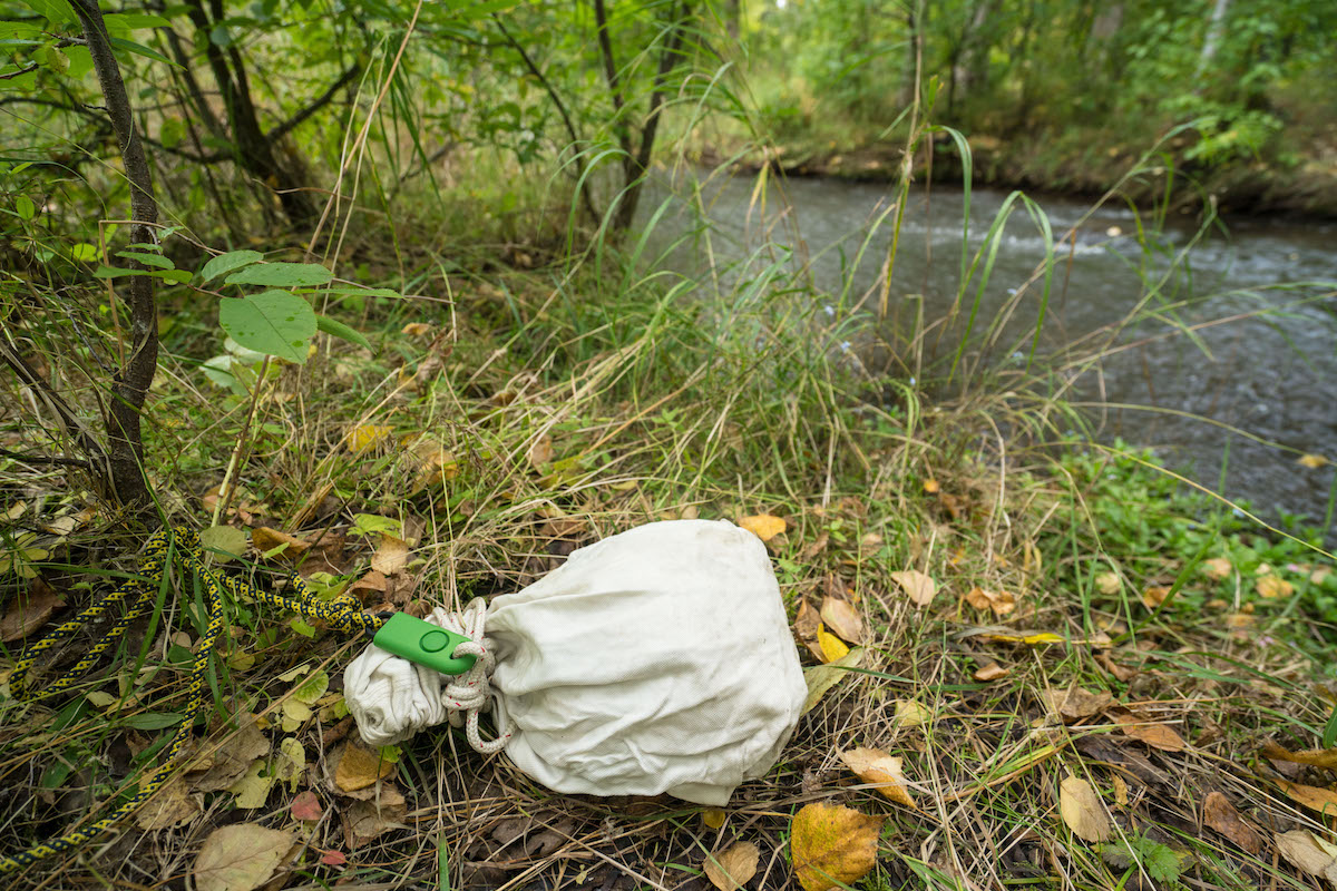 The BASU eAlarm can be used in a variety of ways. Here it is rigged on a food sack so that it will be set off if an animal were to tamper with it. [Photo] Clint Helander