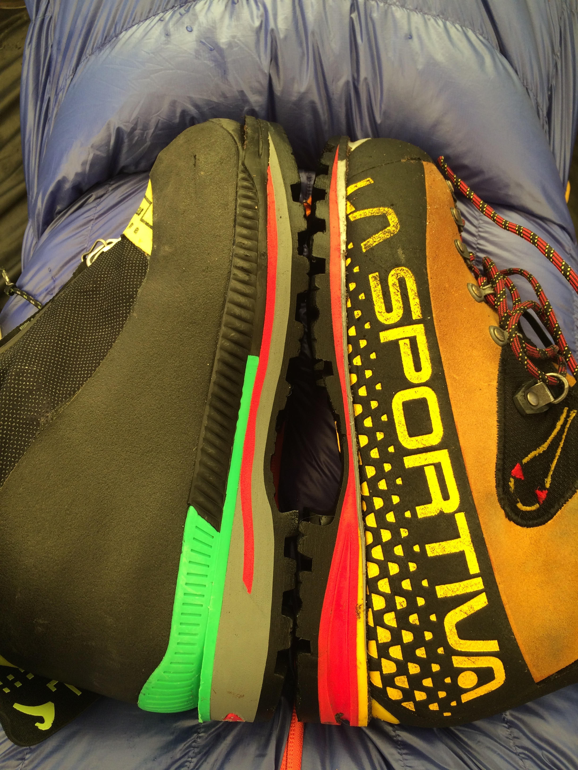 The sole length of the Stetind (left), which fits an American size 9.5 foot, compares to the length of the La Sportiva Nepal Cube, which fits a size 11.5. [Photo] Mike Lewis collection