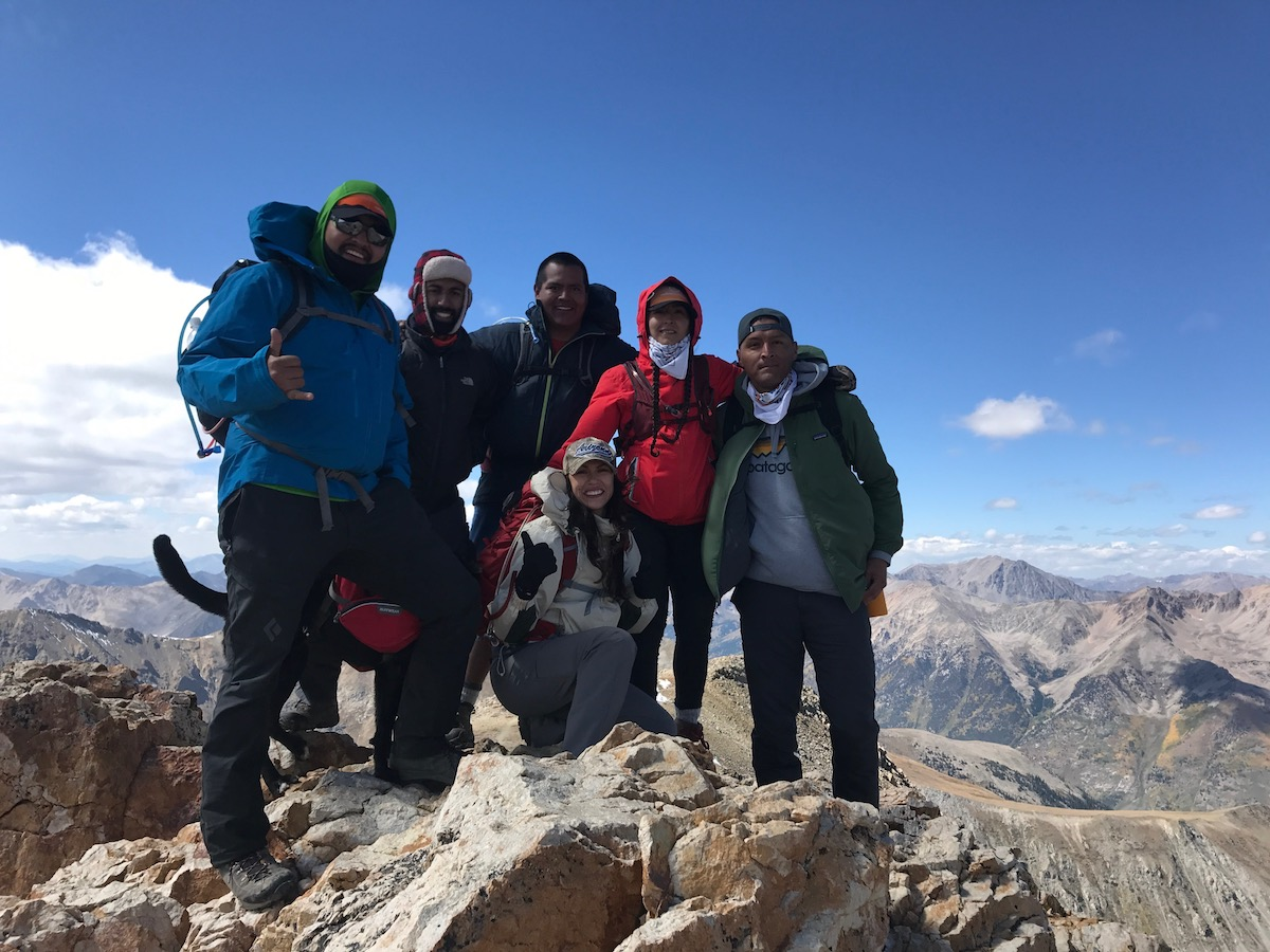 Len Necefer, left, poses on a summit with other members of Natives Outdoors. [Photo] Len Necefer