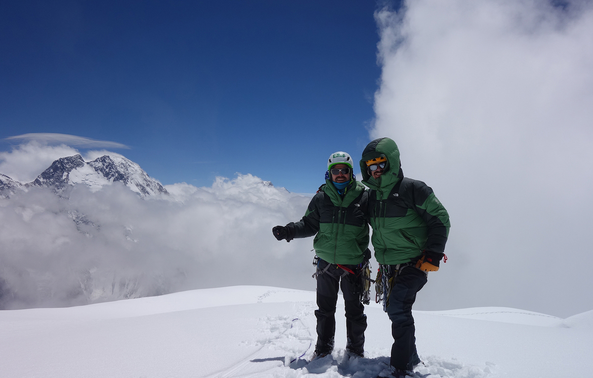 Mora (left) and Bosch stand on the summit of Praqpa Ri South with Broad Peak in the background. They were caught in a storm on the descent and had to spend an extra day at their high camp waiting for conditions to improve. [Photo] Mora/Bosch collection