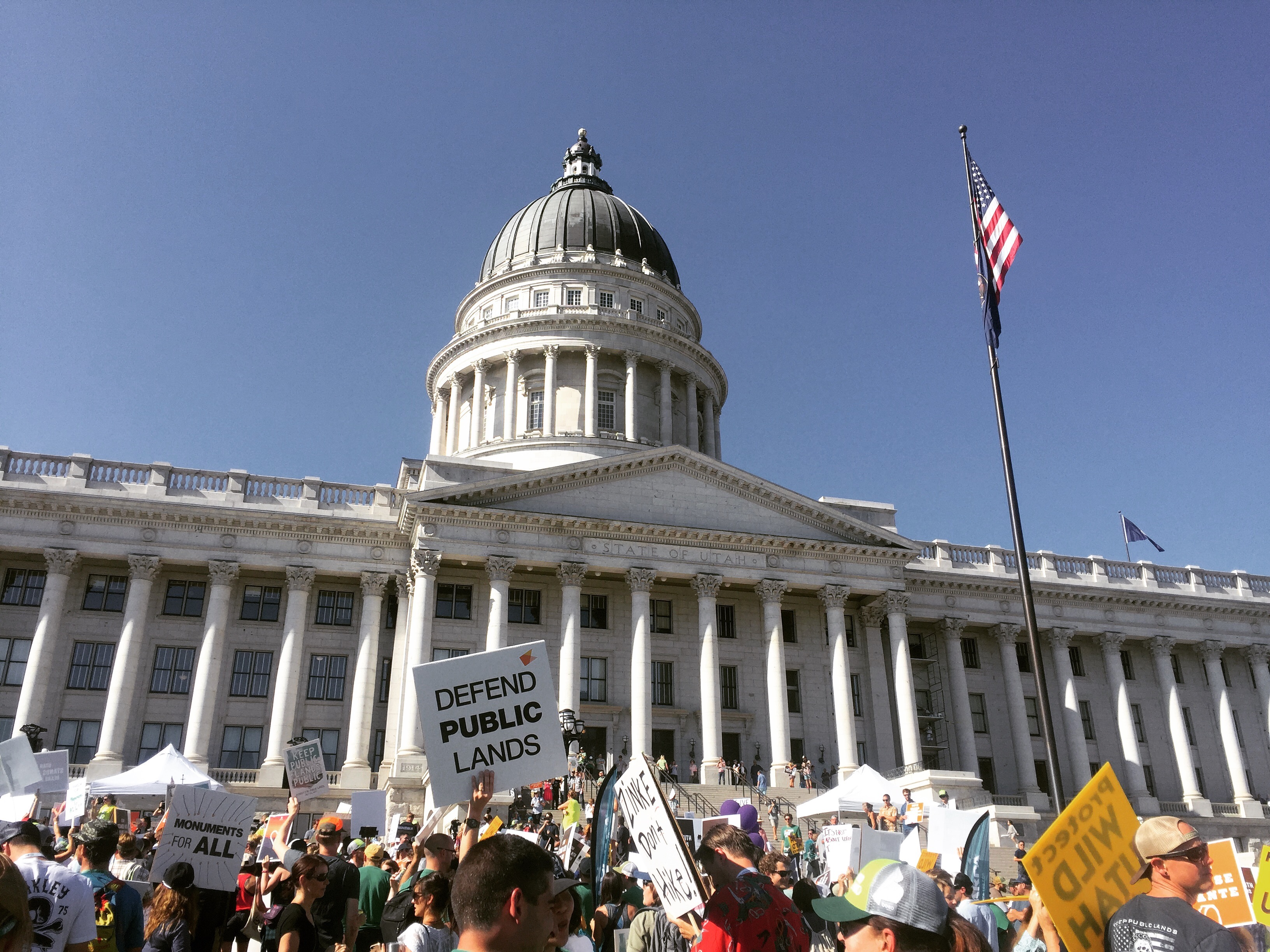 The This Land is Our Land March for Public Lands congregated in front of the Utah capitol in Salt Lake City on July 27 in conjunction with the last Outdoor Retailer Summer Market trade show to be hosted by the city. OR recently agreed to move the trade show to Denver starting next year in response to Utah lawmakers' continued efforts to rescind Bears Ears and Grand Staircase Escalante National Monuments. [Photo] Emma Murray