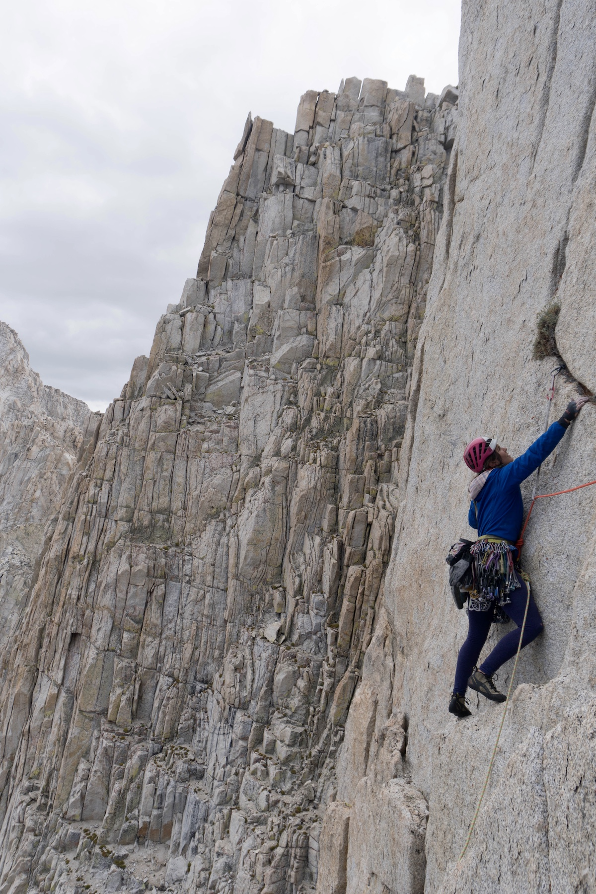 Whitney Clark wears the Patagonia Nano-Air Light Hoody while leading a pitch on the first ascent of High Fashion (5.10, 1,000') on a peak near Wales Lake in the Sierra Nevada Range. The team found a tiny pill container that contained a summit register and identified the mountain as Wales Lake Peak. The register only had two ascents from teams who walked up the backside, Clark said. [Photo] Tad McCrea