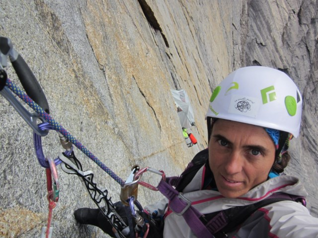 Silvia Vidal pauses for a selfie while cleaning a pitch on her route Une pas mes (VI 5.10b A4/A4+, 11 pitches). [Photo] Silvia Vidal