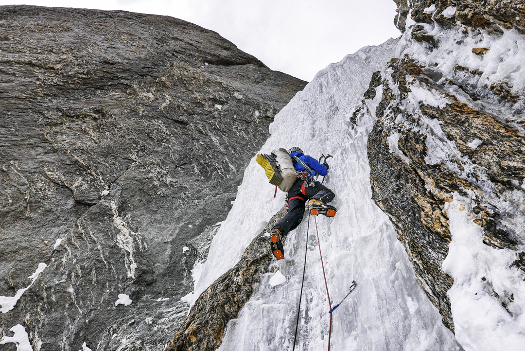 Novak starting the fourth steep pitch on the second day of All or Nothing. Above this the team entered the upper couloir, where they were forced to climb and search for a bivouac spot until midnight. [Photo] Marko Prezelj