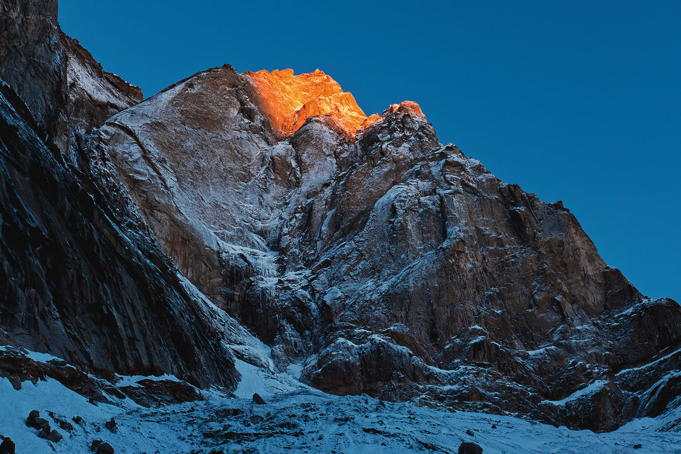 The east face of Cerro Kishtwar gleams in the first morning rays, Day 1. [Photo] Urban Novak