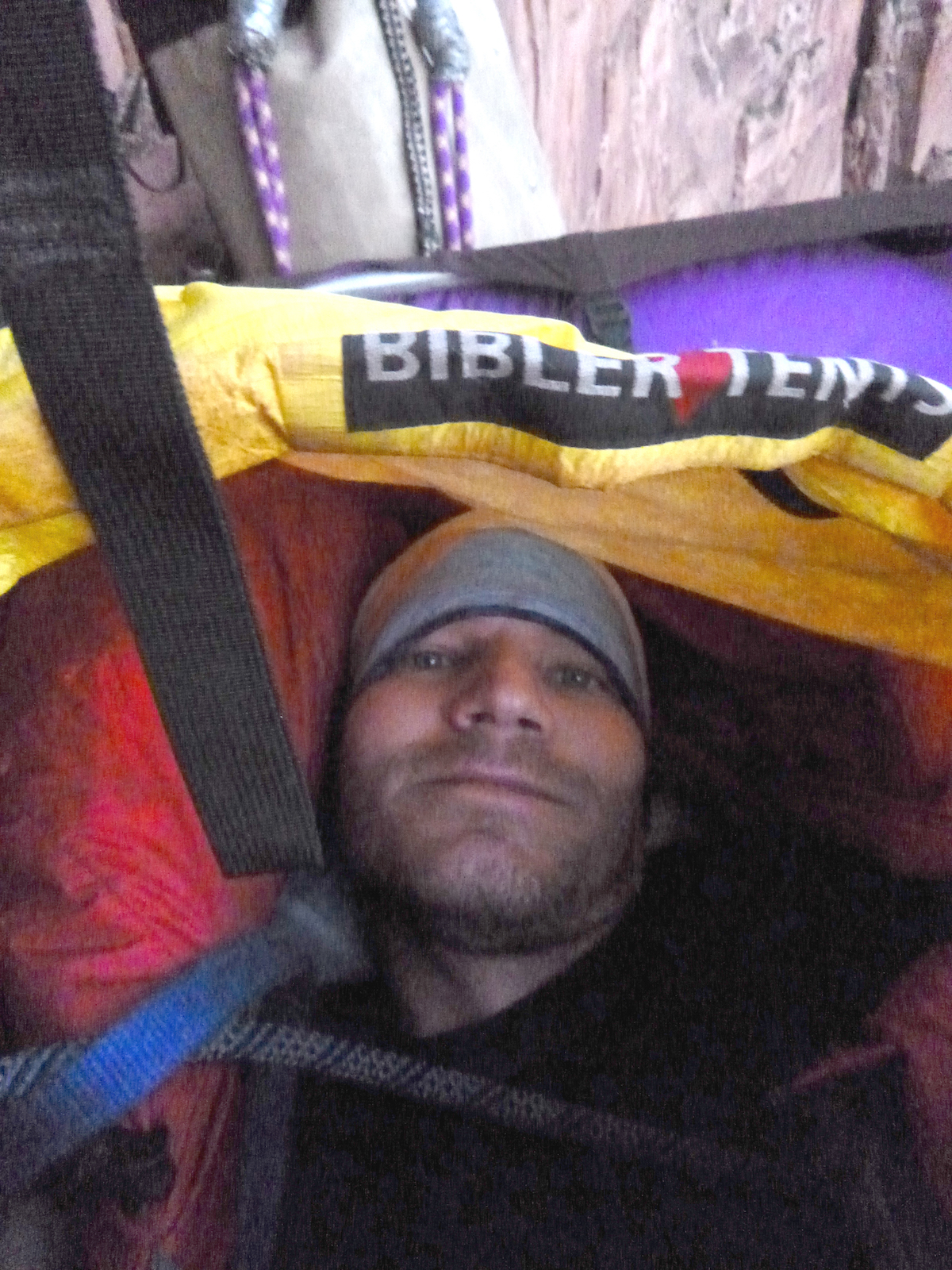 The author enjoys the comfort of the Mountain Equipment Xeros 800-fill, Russian Goose Down sleeping bag inside his bivy sack on the second morning of his solo ascent of Prodigal Sun (V 5.7 C2, 900') in Zion National Park, October 22. [Photo] Derek Franz