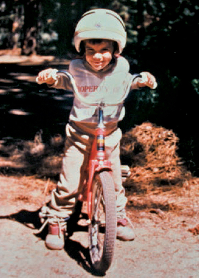 Honnold at Lake Tahoe, California, during his third summer. His mother says, Alex rode a 2-wheeler from the age of about 2 and a half—which scared the bejeebers out of all the moms in our court. [Photo] Courtesy Dierdre Wolownick