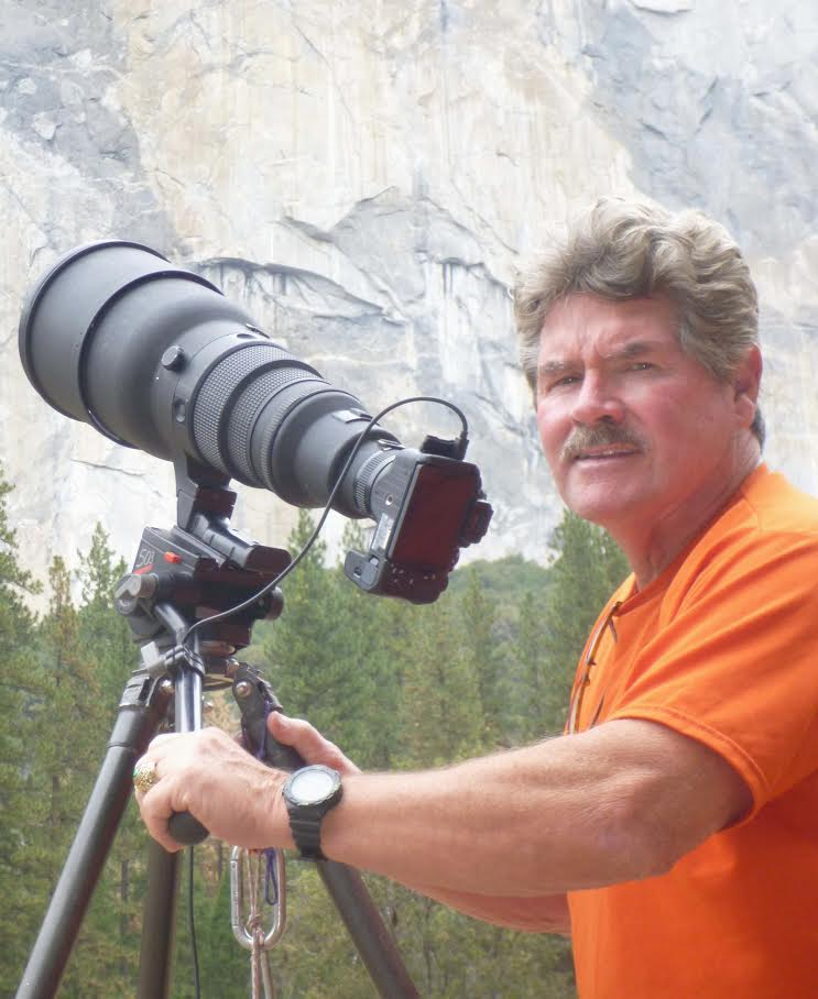Tom Evans below El Capitan with his telescope-mounted camera. [Photo] Earl Bates