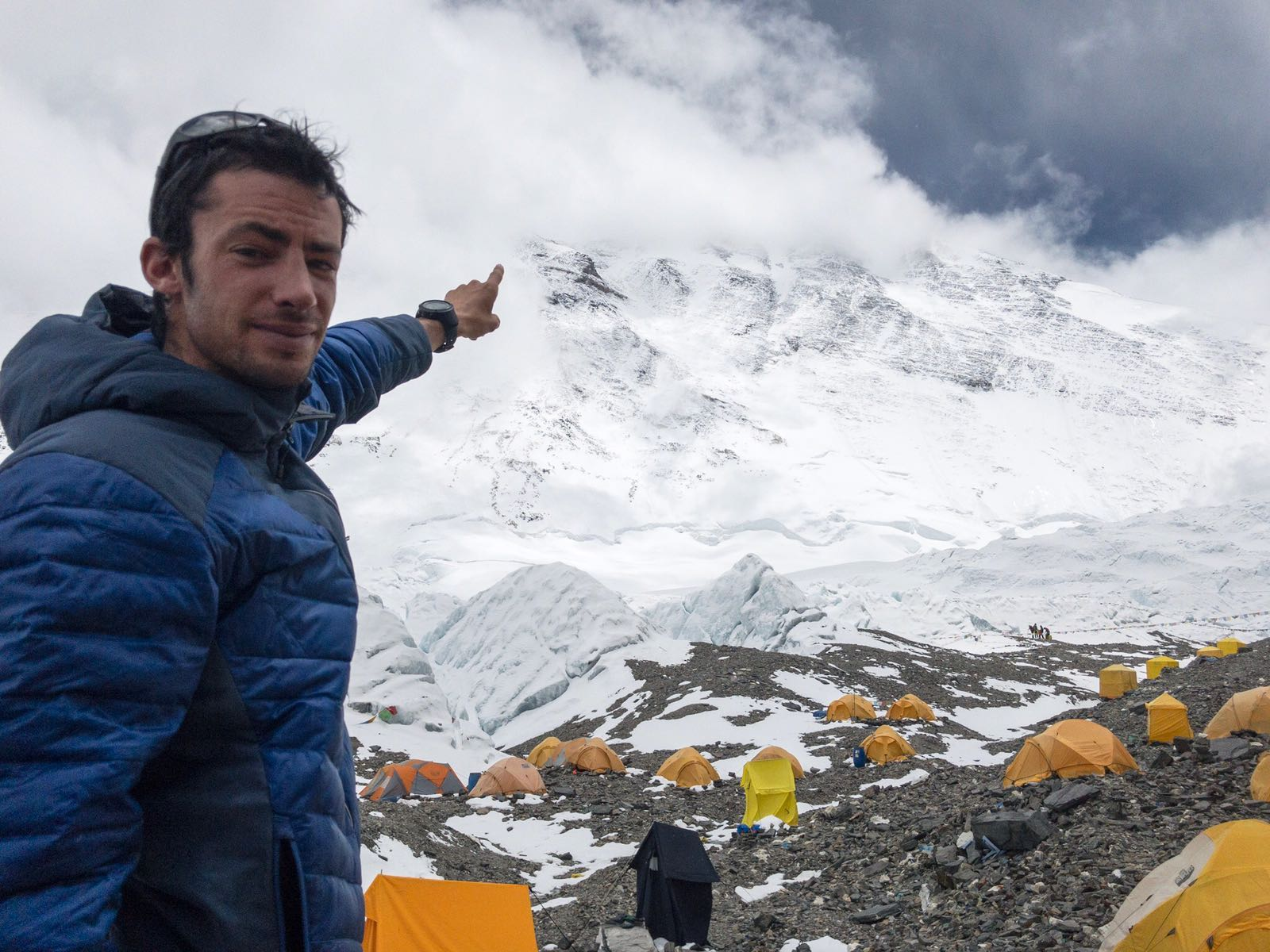Kilian Jornet points to Mt. Everest's shrouded summit while acclimatizing for his first speed ascent of the North Col route. [Photo] Sebastien Montaz-Rosset/Kilian Jornet collection
