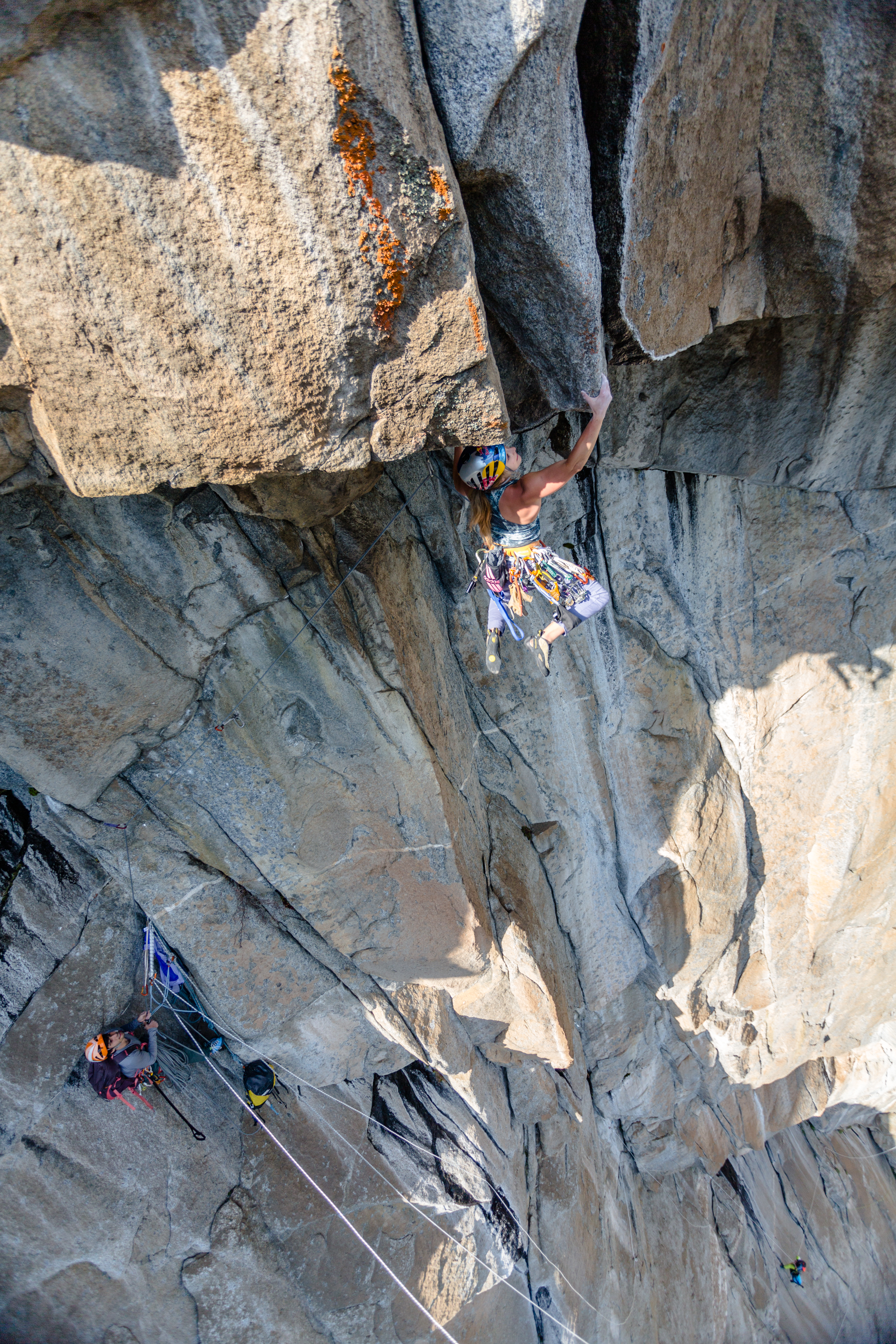 DiGiulian works the moves of the 5.13 roof crux on the Misty Wall before her free ascent with Cardwell, who is at the belay. [Photo] John Evans