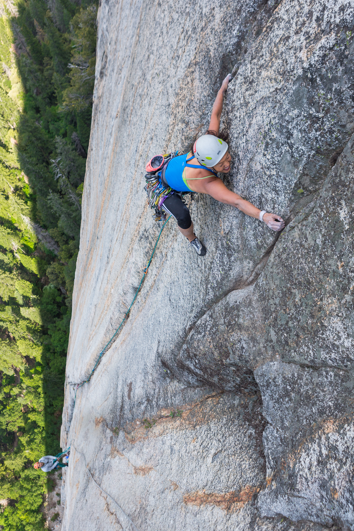 Rita Shin fires Cosmic Girl (5.12+, 1,200') on Yosemite's Middle Cathedral. The route starts on the Chouinard-Pratt route—which is the same start as the modern version of the extremely popular Central Pillar of Frenzy (5.9)—but Cosmic Girl continues straight up where the Central Pillar traverses left into another crack system. [Photo] John Evans