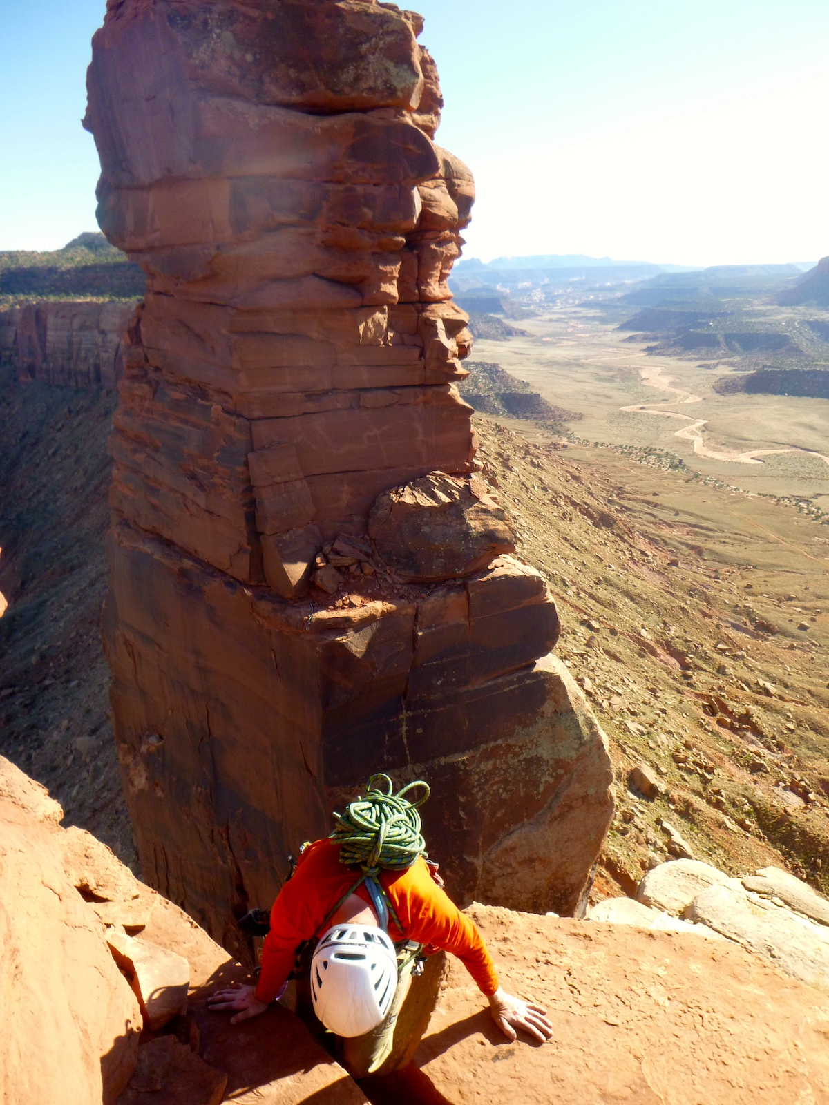 Ryan Franz down climbs from the summit of Bridger Jack Butte to access a rappel station in April 2015. The King of Pain pinnacle is in the background. The area is part of the Bears Ears National Monument designated by outgoing President Barack Obama on December 28, 2016. [Photo] Derek Franz