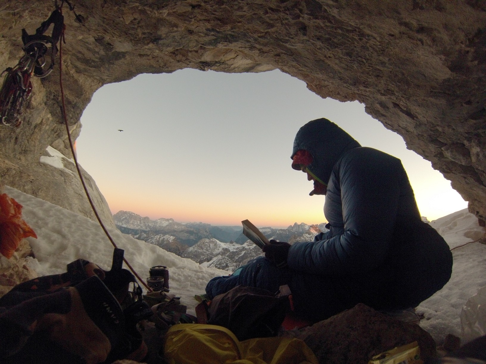 Ballard enjoys some reading on the comforts of a bivy ledge during his rope-solo of the Gogna Route (5.10, 800m) on Marmolada Punta Rocca (3309m), Dolomites, Italy. [Photo] Tom Ballard