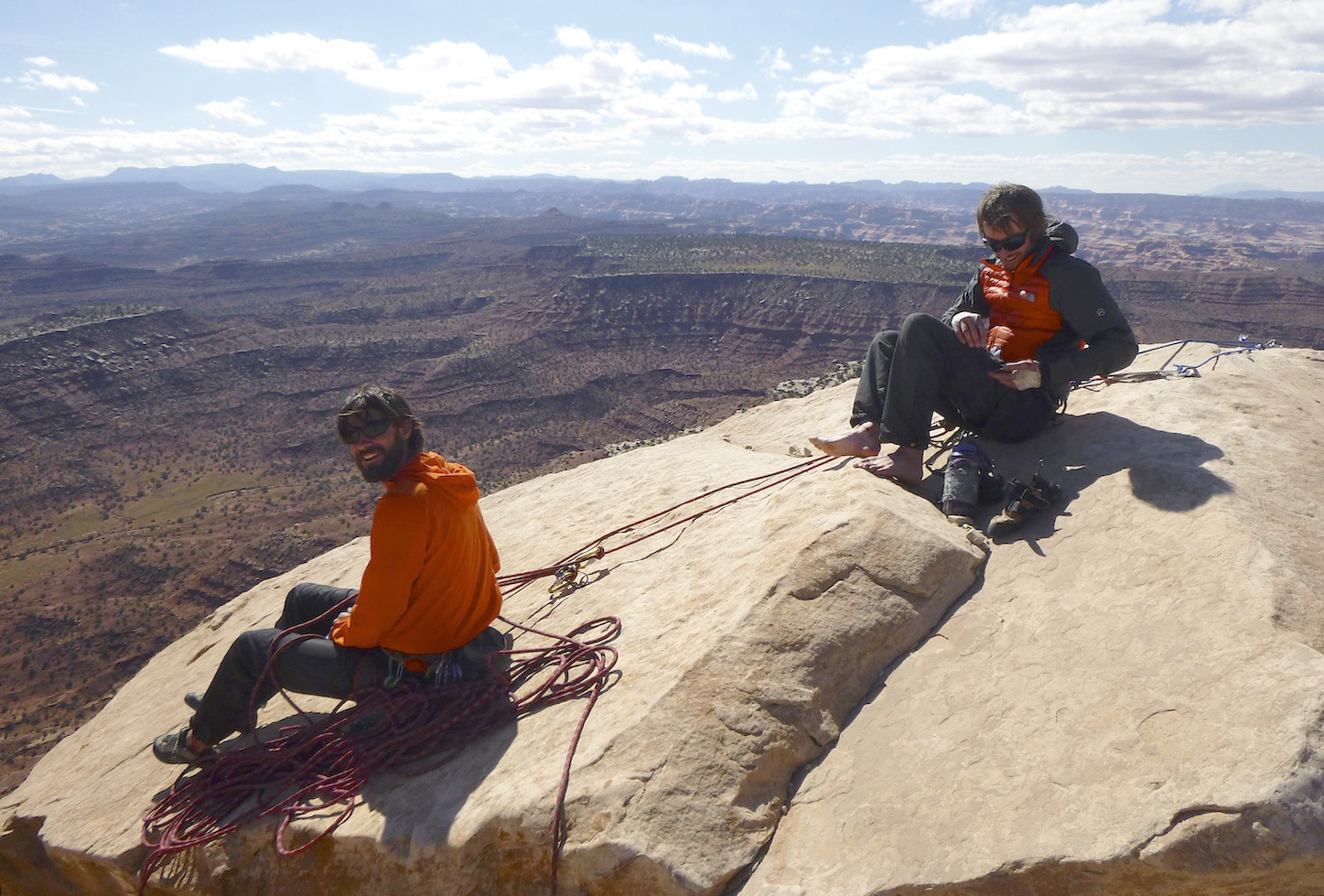 Nathan Martinez and Steve Dilk sit atop North Six Shooter in Indian Creek, Utah, in 2013. The area is now included in Bears Ears National Monument. Canyonlands National Park is in the background. [Photo] Derek Franz