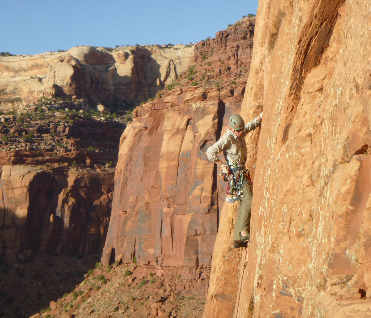 John Tucker plugs gear on Evening Ecstacy (5.9+) in Indian Creek, 2015. [Photo] Derek Franz